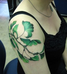 Green leaf tattoo