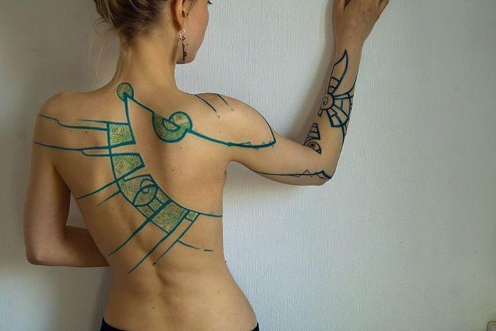 Green tattoo by Grisha Maslov