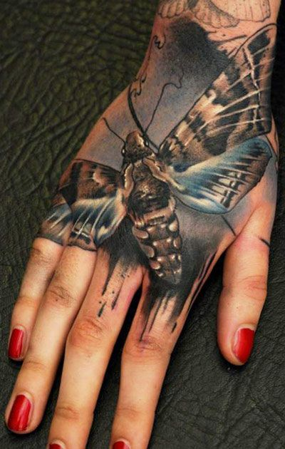 Hand insect tattoo