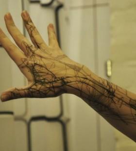 Hand tattoo by Grisha Maslov