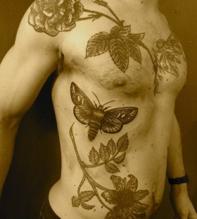Insects and flowers tattoo made by Berlin artist