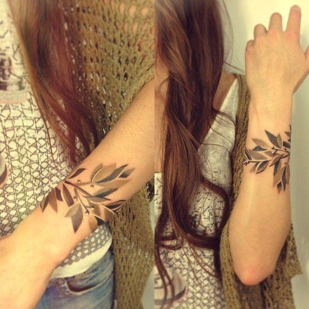 Lovely girl's leaf tattoo