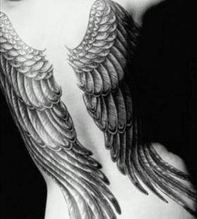 Lovely woman wings tattoo