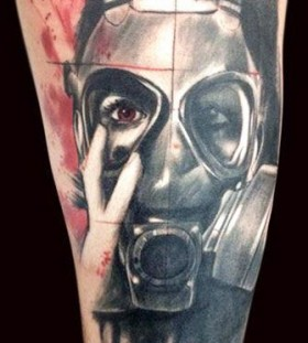 Man with mask tattoo by Adam Kremer