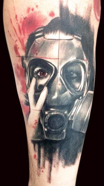 Man with mask tattoo by Adam Kremer
