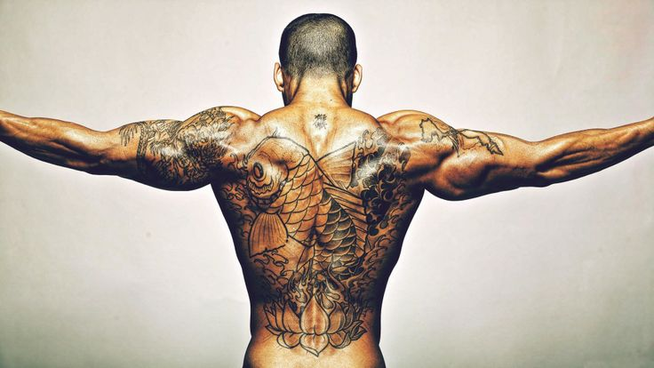 Men's back fish and infinity tattoo