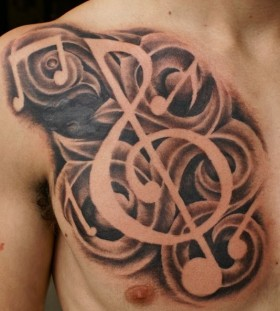 Men's chest music style tattoo