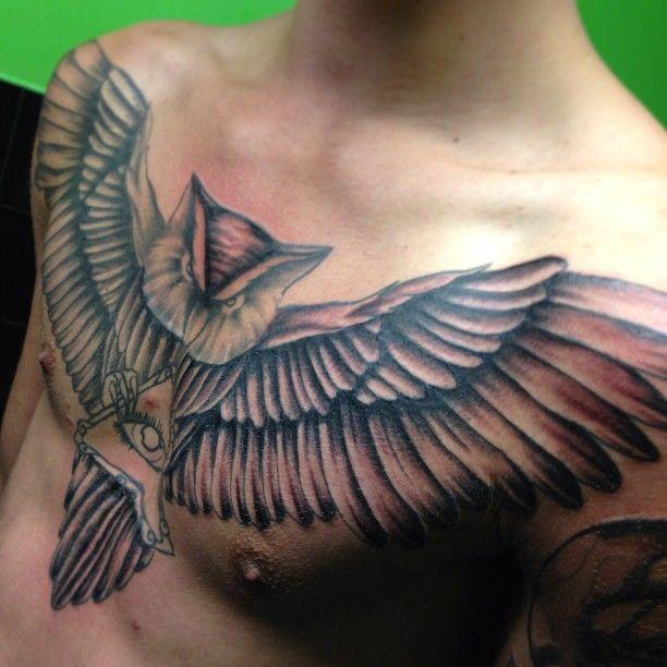 Men's chest owl tattoo