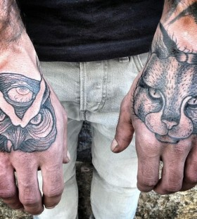 Men's hand cat and owl tattoo