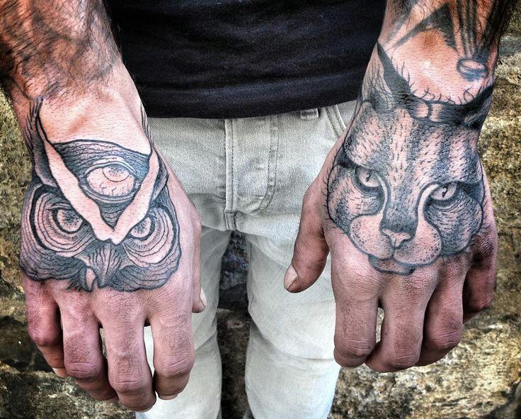 Men's hand cat and owl tattoo