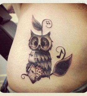 Music, heart and owl tattoo