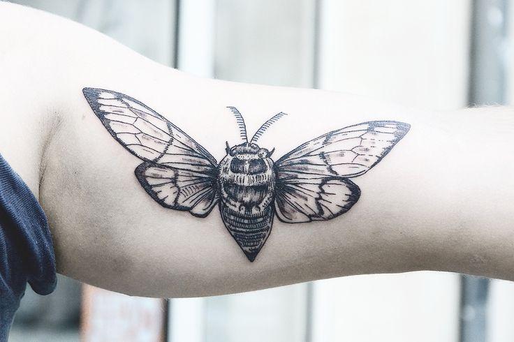 Pretty black insect tattoo