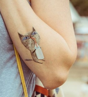 Pretty cat tattoo made by Berlin artist