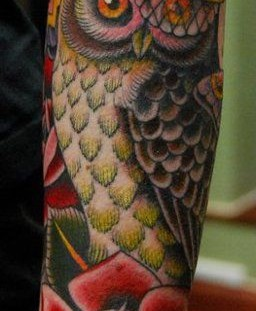 Pretty colorful owl tattoo