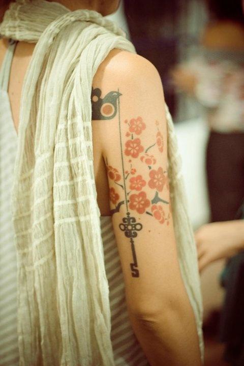 Pretty flowers red tattoo