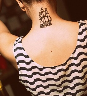 Pretty girl's ship tattoo