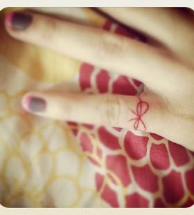 Pretty red bow tattoo