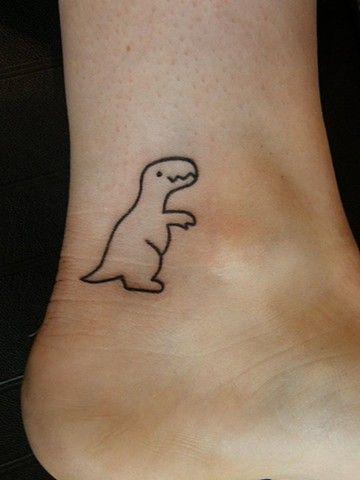 Pretty smiling dinosaur tattoo