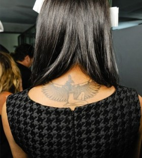 Pretty women's back Egypt style tattoo