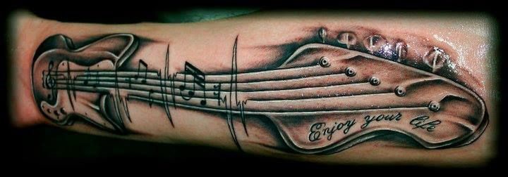 Quote and guitar tattoo