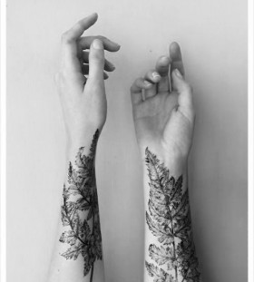 Realistic hand leaf tattoo