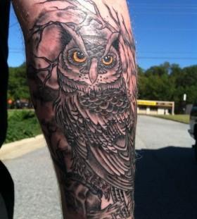 Realistic hand owl tattoo