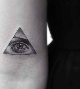 Realistic woman eye tattoo