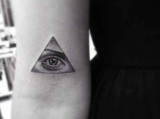 Realistic woman eye tattoo