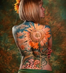 Realistic woman sunflower tattoo