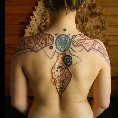 Red and black tattoo by Grisha Maslov
