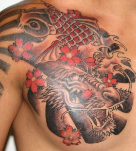 Red fish flowers and dragon tattoo