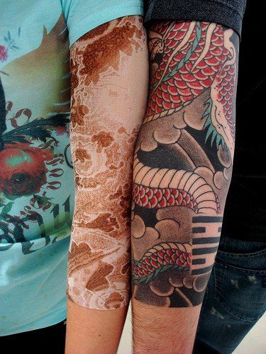 Red snake lace tattoo