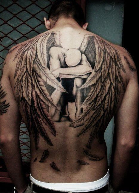 Sad angel wings tattoo