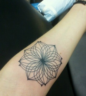 Simple hand lotus flower tattoo