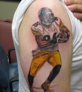 Simple shoulder football tattoo