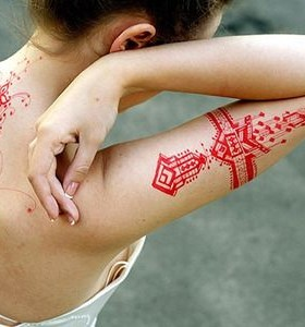 Simple woman red tattoo