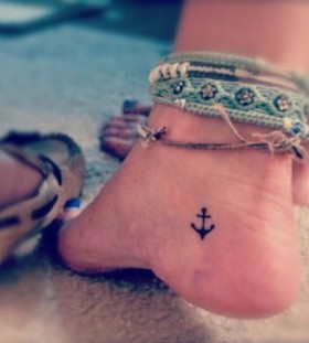 Small anchor girl tattoo