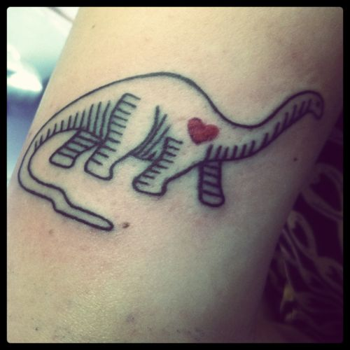 Small red heart and dinosaur tattoo