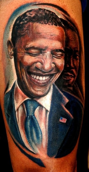 Smiling Obama american president tattoo