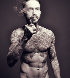 Smoking men tattoo on chest