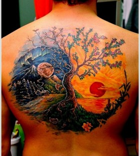 Sun and tree tattoo