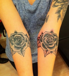 Two roses blue and red tattoo made by Berlin artist