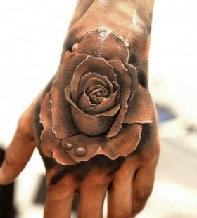 Water and rose realistic tattoo