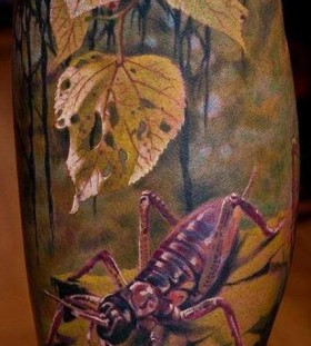 Watercolor insect tattoo