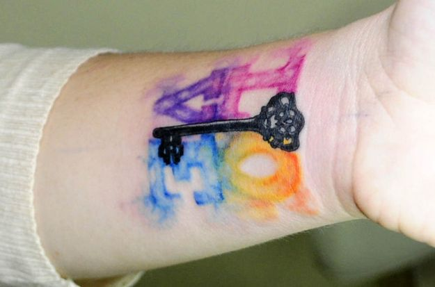 Watercolor key painting tattoo