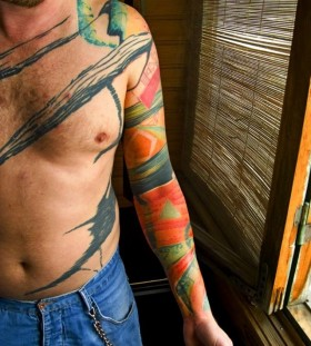Watercolor men's tattoo by Grisha Maslov