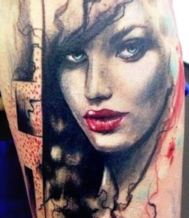 Woman with red lips tattoo by Adam Kremer