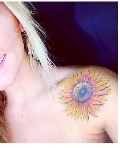Yellow woman sunflower tattoo