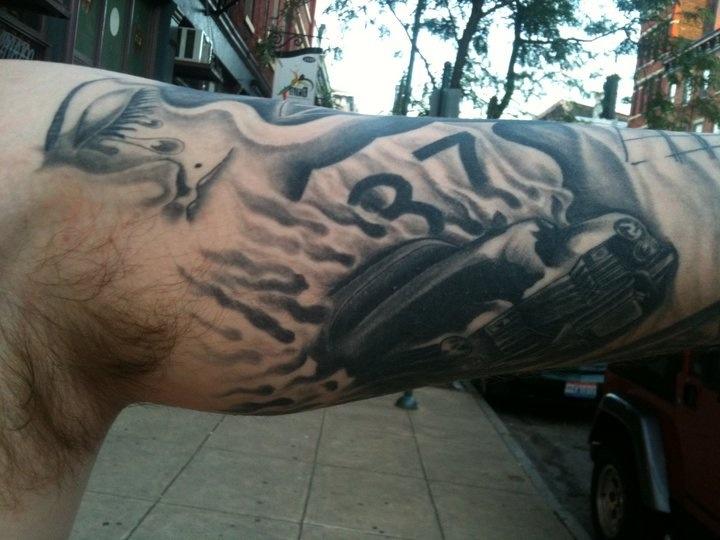 37 black simple car tattoo on arm