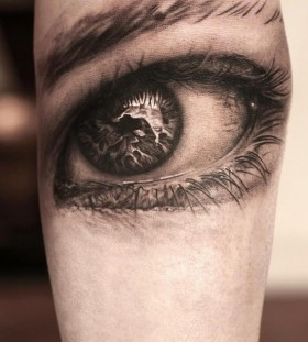 3D black eye tattoo on arm